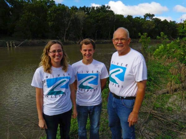 people standing by the river in River Keepers t-shirts